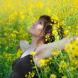Stock Photo: Woman lying in flowers