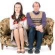 Bored couple on couch — Stock Photo