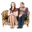 Kitsch couple on sofa — Stock Photo #13372856