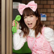 Japanese lolita public phone — Stock Photo