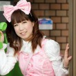 Japanese lolita cosplay shouting in public phone — Stockfoto