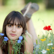 Teen girl in flowers — Stockfoto