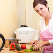 Woman cutting vegetables — Stock Photo #13376456