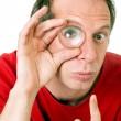 Man with eye magnified — Stock Photo #13376743