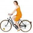 Girl riding bicycle — Stock Photo