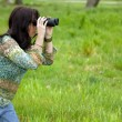 Stock Photo: Womobserving wildlife