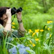 Woman birdwatching - Stock Photo