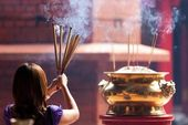 Woman holding incense sticks — Stock Photo