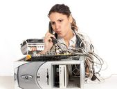 Young business woman calling technology support for the broken computer — Stock Photo