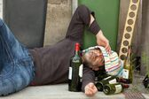 Drunk man lying — Stock Photo