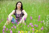 Woman in wild flowers — Stock Photo