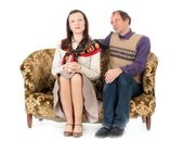 Kitsch couple on sofa — Stock Photo