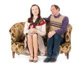 Kitsch couple on sofa — Stock Photo