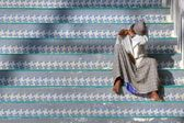 Indian Muslim on stairs — Stock Photo