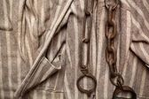 Prisoner chains and clothes — Stock Photo