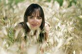 Girl in summer meadow — Stock Photo