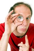 Man with eye magnified — Stock Photo