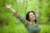 Woman in green forest — Stock Photo