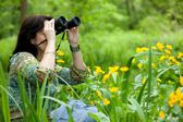 Woman birdwatching — Stock Photo