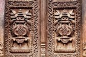 Wooden carved door detail — Stock Photo