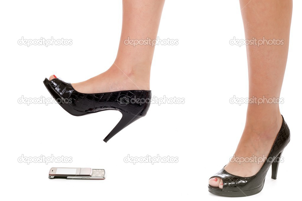 Woman foot crushing cellular phone isolated on white — Stock Photo #13376277