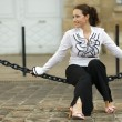 Woman sitting on chain — Stock Photo