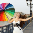 Woman walking with umbrella — Stockfoto