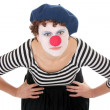 Young woman wearing clown face bending over and looking at camera — Stock Photo