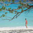 Girl on tropical beach — Stock fotografie