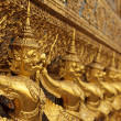 Golden asian statues - Stock Photo