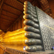Golden reclining buddha — Stock Photo