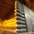 Golden reclining buddha - Stock Photo