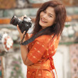 Asian woman photographer — Stock Photo