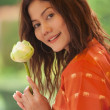 Asian woman holding lotus flower — Stock Photo