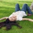 Stock Photo: Womlying on grass