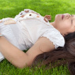 Stock Photo: Womrelaxing on grass