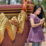 Asian woman praying — Stock Photo #13382724
