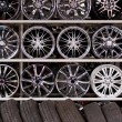 Stock Photo: Alloy car wheels wall