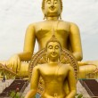 Two golden buddha - Stock Photo