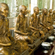 Golden monk statues - Stock Photo