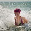 Womin splashing wave — Stock Photo #13383145