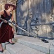 Stock Photo: Religious cleaner woman