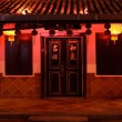 Illuminated chinese house — Stock Photo