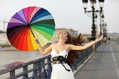 Woman walking with umbrella — Stock Photo