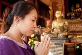 Asian woman praying — Stock Photo