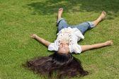 Woman lying on grass — Stock Photo