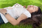 Woman relaxing on grass — Stock Photo