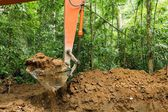 Earth mover in forest — Foto de Stock