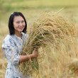 Woman holding rice — Stock Photo