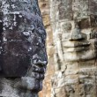 Angkor face sculpture - Stock Photo